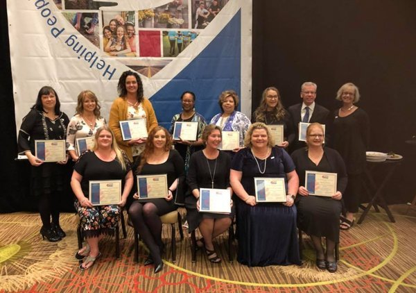 IACAA Programs & Incentives: Class receiving certificates after IACCA Classes