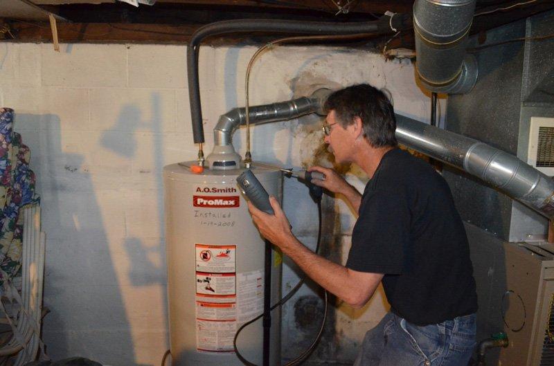 Repair Man Working on Water Heater